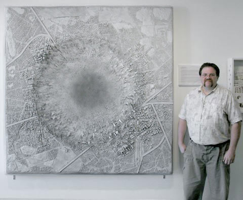 "Artist Thomas Keefer standing next to ""The Imminent Thunder"""